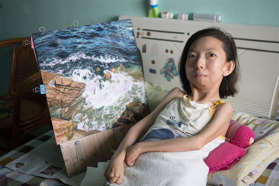 30 năm vẽ tranh, cô gái này chứng minh dù cơ thể bại liệt nhưng tâm hồn vẫn giúp ta tỏa sáng