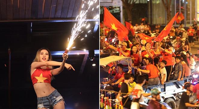 """Hà Nội, Sài Gòn """"đi bão"""" mừng chiến thắng bán kết AFF Cup: Cờ rợp đường, nhảy múa cùng pháo sáng"""