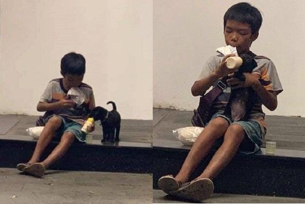 Khoảnh khắc cậu bé lem luốc chia bánh mì và sữa cho chú cún nhỏ khiến nhiều người suy ngẫm