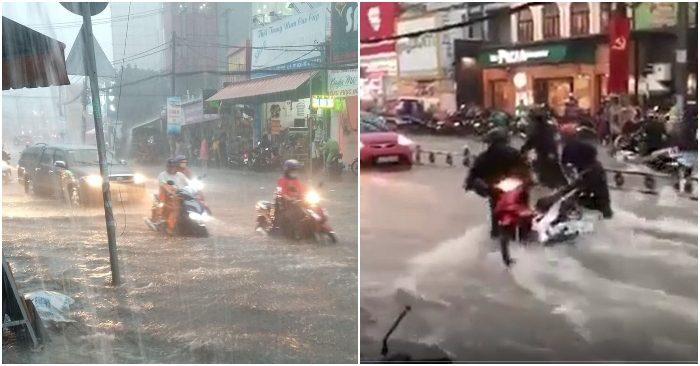 Người và xe bơi trong biển nước tại Sài Gòn, sau cơn mưa nước đổ như thác