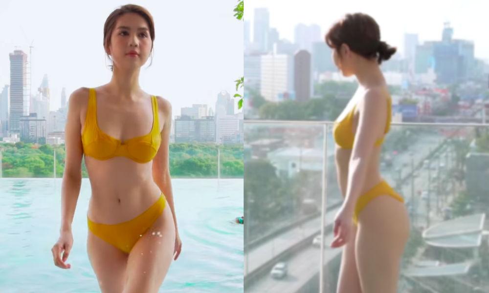 """""""Bấn loạn"""" trước đường cong cực nuột của Ngọc Trinh khi diện bikini vàng rực giữa lòng thành phố Bangkok"""
