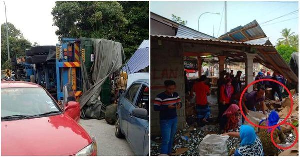 Xe tải chở sữa bị lật, dân làng thi nhau chạy ra hôi của mặc kệ lời van xin của tài xế