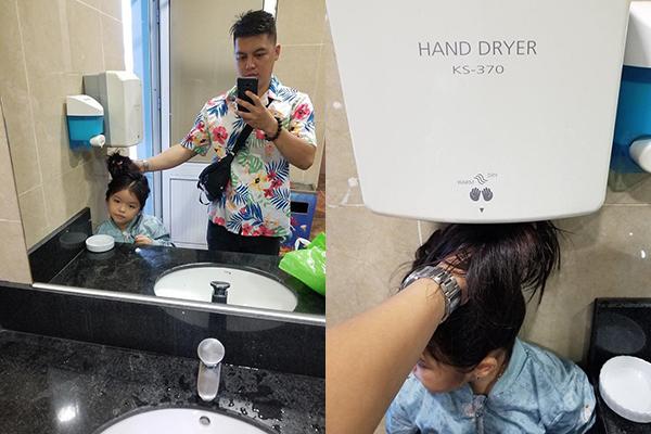 """Ông bố """"tiện thể"""" nhất năm: Trưng dụng ngay máy sấy tay trong nhà vệ sinh công cộng để làm máy sấy tóc cho con gái"""