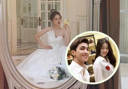 Á hậu Bùi Phương Nga khoe ảnh mặc váy cô dâu cực xinh, dân tình thi nhau dự đoán ngày cưới Bình An