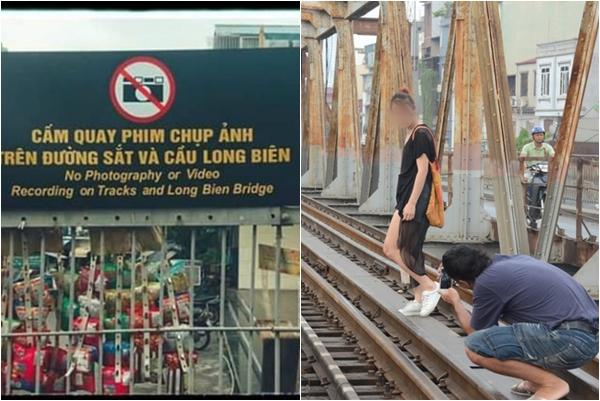 """""""Chào thua"""" trước độ """"sống ảo"""" của giới trẻ: Treo biển cấm quay phim, chụp ảnh ở cầu Long Biên vẫn không ăn thua"""