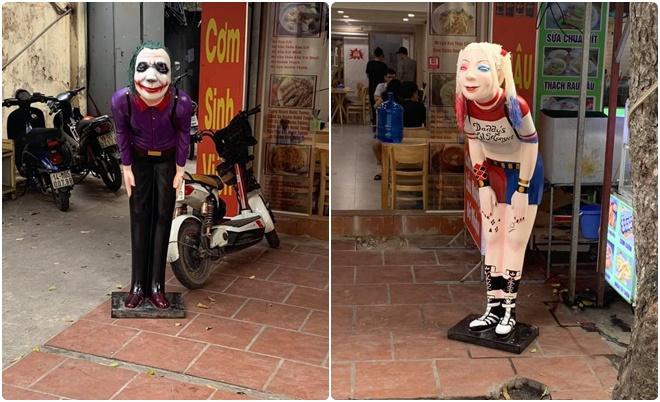 """Chủ quán cơm sinh viên chơi trội để tượng Joker và Harley Quinn ngoài cửa """"câu khách"""""""