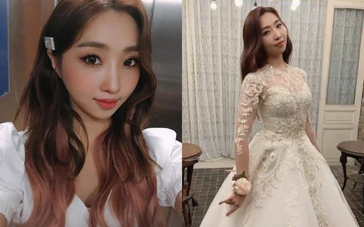 Fans chưa hết hoang mang, Minzy bất ngờ đăng clip mặc váy cưới kèm chú thích ẩn ý