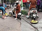 Chủ shop đi xe cán nát rổ hoa quả và buông lời chửi tục tĩu cô bán hàng rong nghèo khổ chỉ vì bày bán trước cửa hàng