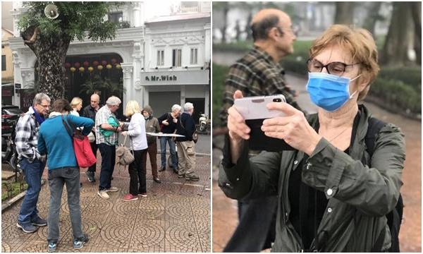 Từ hôm nay, khách nước ngoài bắt buộc phải đeo khẩu trang khi tham quan du lịch Hà Nội