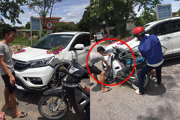 """Chủ xế hành động cao thượng khi bị bác tài xế xe máy tông móp đầu ô tô: """"Chú đi bán hoa vất vả, để cháu tự sửa xe"""""""