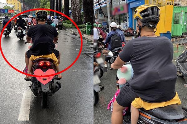 """Đang đi đường thì trời đổ cơn mưa, bé gái nhanh trí chui tọt vào áo bố: """"Đố ai tìm được nơi nào ấm áp hơn nhé"""""""