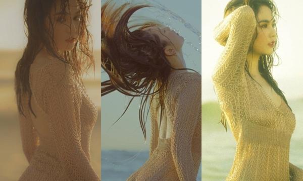 Diện 2 mảnh ngoài bãi biển đã xưa rồi. Cứ thả dáng bằng áo lưới như Ngọc Trinh lại càng sexy mướt mát