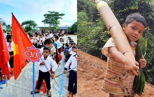 Cậu bé vác măng đi chống dịch khiến dân tình đua nhau thả tim khi cầm cờ ngày khai giảng